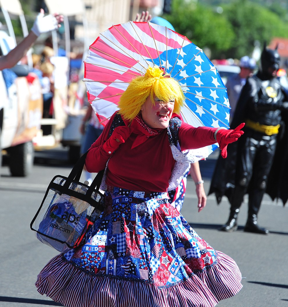 Arizona Public Service clown during the Prescott Frontier Days Rodeo Parade through the streets of downtown Prescott Saturday July 6, 2019.  (Les Stukenberg/Courier)