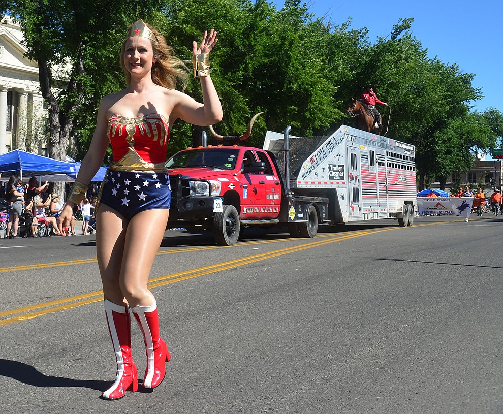 Wonder Woman and the One Armed Bandit during the Prescott Frontier Days Rodeo Parade through the streets of downtown Prescott Saturday July 6, 2019.  (Les Stukenberg/Courier)