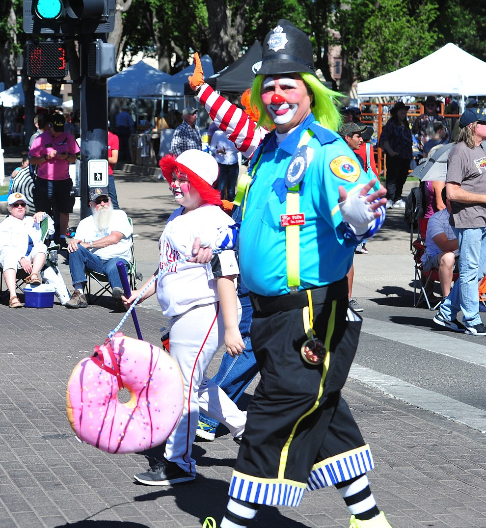 A Shriner clown during the Prescott Frontier Days Rodeo Parade through the streets of downtown Prescott Saturday July 6, 2019.  (Les Stukenberg/Courier)