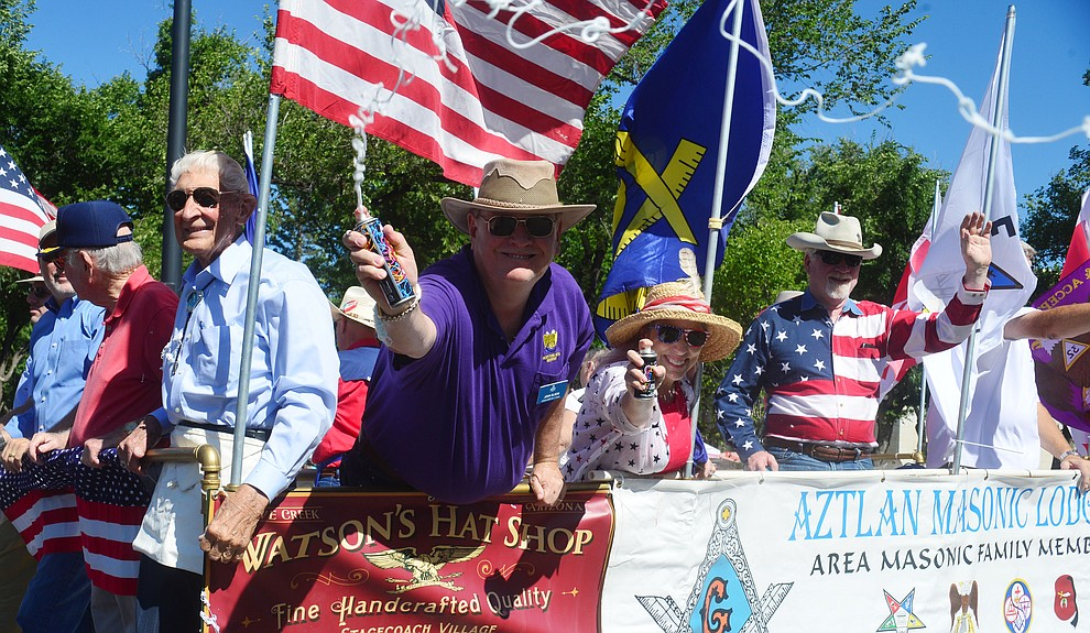 Aztlan Masonic Lodge had silly string during the Prescott Frontier Days Rodeo Parade through the streets of downtown Prescott Saturday July 6, 2019.  (Les Stukenberg/Courier)