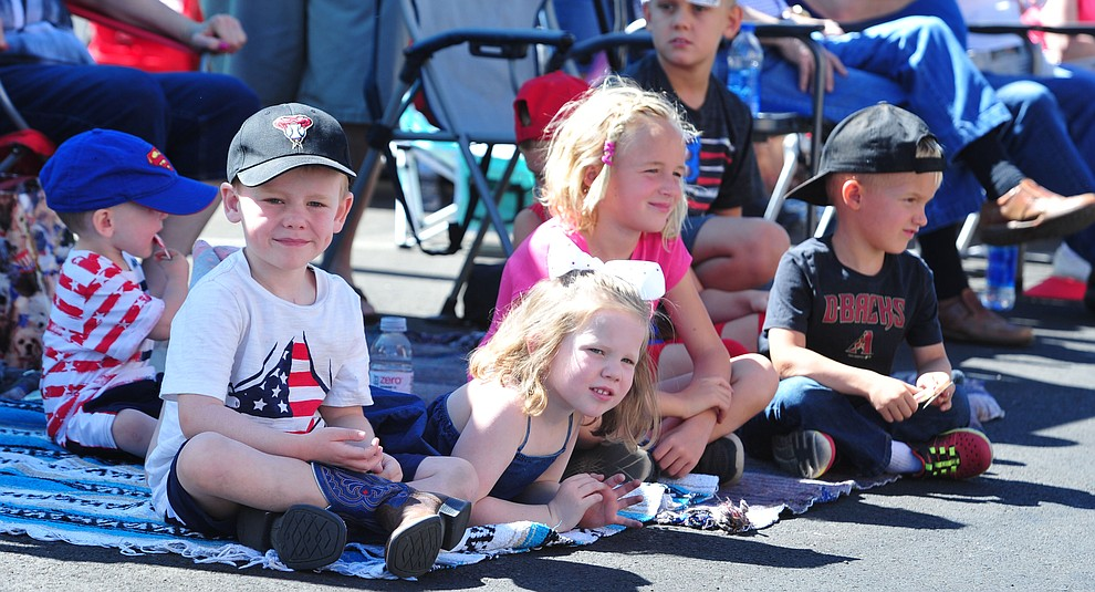 The McFadden kids during the Prescott Frontier Days Rodeo Parade through the streets of downtown Prescott Saturday July 6, 2019.  (Les Stukenberg/Courier)