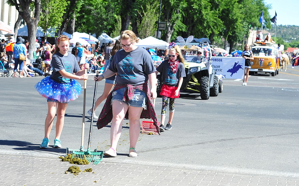 Pooper scoopers were kept busy but they kept their smiles during the Prescott Frontier Days Rodeo Parade through the streets of downtown Prescott Saturday July 6, 2019.  (Les Stukenberg/Courier)