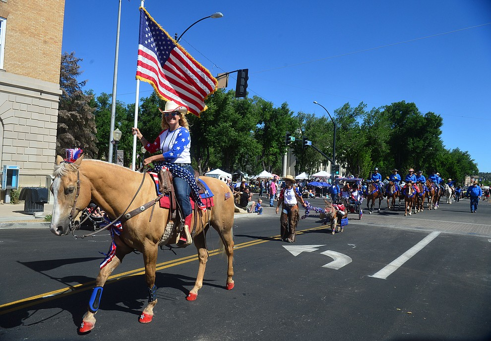 Back Country Horsemen of Central Arizona during the Prescott Frontier Days Rodeo Parade through the streets of downtown Prescott Saturday July 6, 2019.  (Les Stukenberg/Courier)