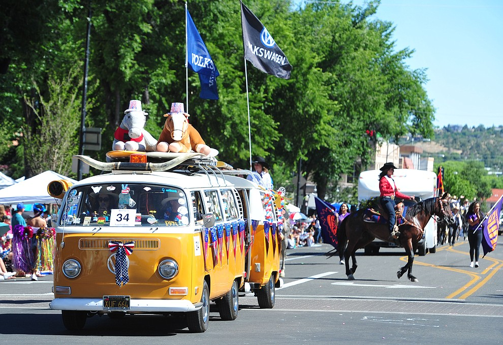 The surf bus during the Prescott Frontier Days Rodeo Parade through the streets of downtown Prescott Saturday July 6, 2019.  (Les Stukenberg/Courier)