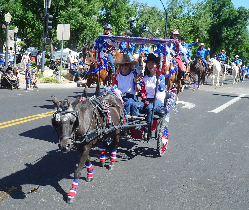 The Backcountry Horsemen of Central Arizona during the Prescott Frontier Days Rodeo Parade through the streets of downtown Prescott Saturday July 6, 2019.  (Les Stukenberg/Courier)
