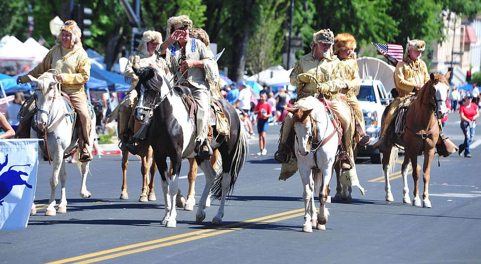 Bill WIlliams Mountain Men during the Prescott Frontier Days Rodeo Parade through the streets of downtown Prescott Saturday July 6, 2019.  (Les Stukenberg/Courier)