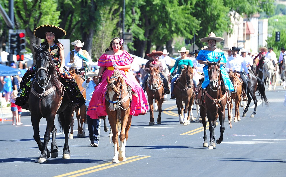 Pepe's Painting sponosred this large equestrain group during the Prescott Frontier Days Rodeo Parade through the streets of downtown Prescott Saturday July 6, 2019.  (Les Stukenberg/Courier)
