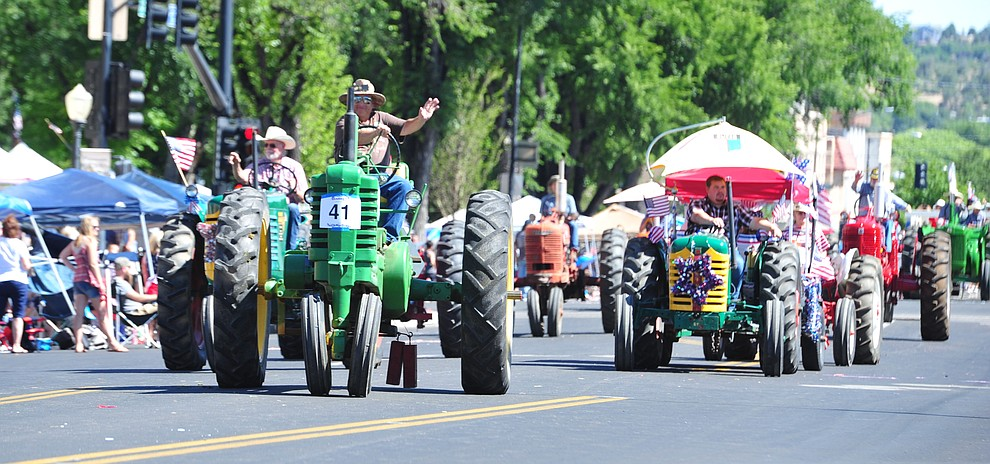Mile High Tractor and Engine Club during the Prescott Frontier Days Rodeo Parade through the streets of downtown Prescott Saturday July 6, 2019.  (Les Stukenberg/Courier)