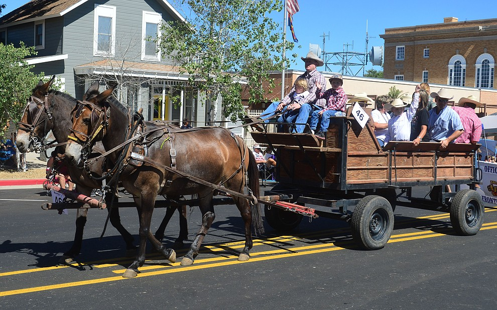 An honorary pioneer family during the Prescott Frontier Days Rodeo Parade through the streets of downtown Prescott Saturday July 6, 2019.  (Les Stukenberg/Courier)