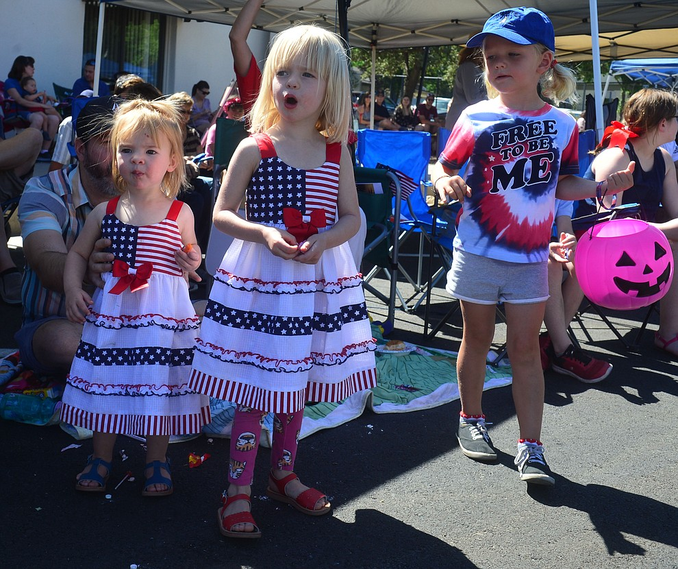 June and Grace Cline with Henrietta Porter during the Prescott Frontier Days Rodeo Parade through the streets of downtown Prescott Saturday July 6, 2019.  (Les Stukenberg/Courier)
