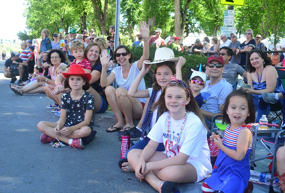 Crowds cheer during the Prescott Frontier Days Rodeo Parade through the streets of downtown Prescott Saturday July 6, 2019.  (Les Stukenberg/Courier)