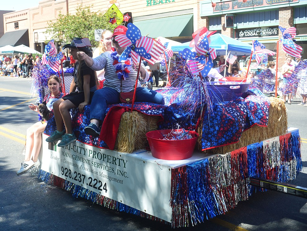 Tri-City Property Management brought a small but colorful float to the Prescott Frontier Days Rodeo Parade through the streets of downtown Prescott Saturday July 6, 2019.  (Les Stukenberg/Courier)