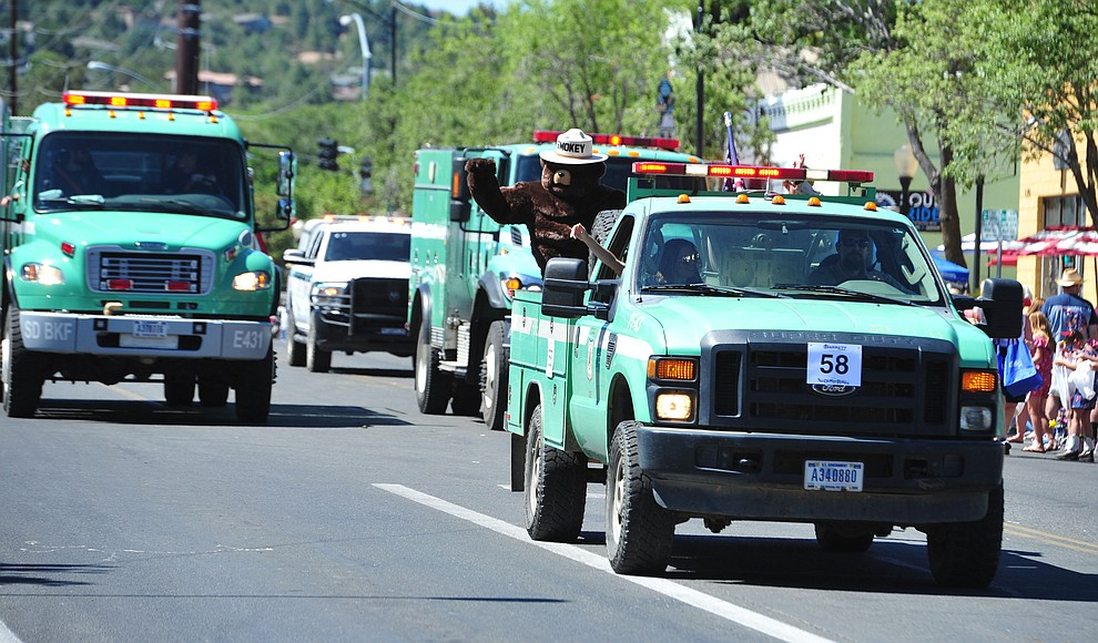 Smokey Bear and the Prescott National Forest during the Prescott Frontier Days Rodeo Parade through the streets of downtown Prescott Saturday July 6, 2019.  (Les Stukenberg/Courier)
