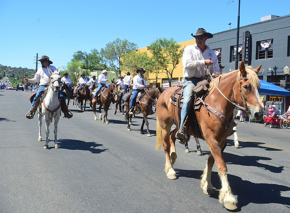 Pony Express riders during the Prescott Frontier Days Rodeo Parade through the streets of downtown Prescott Saturday July 6, 2019.  (Les Stukenberg/Courier)
