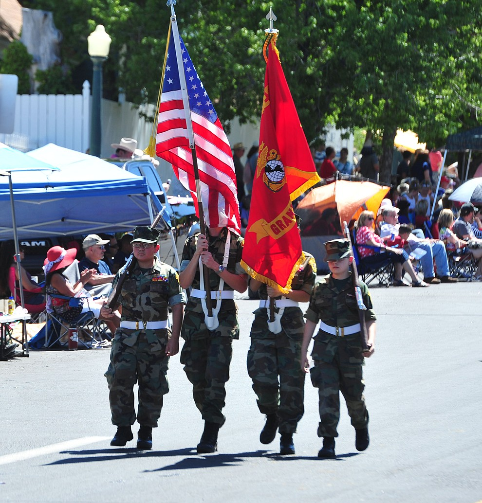 Young Marines march during the Prescott Frontier Days Rodeo Parade through the streets of downtown Prescott Saturday July 6, 2019.  (Les Stukenberg/Courier)