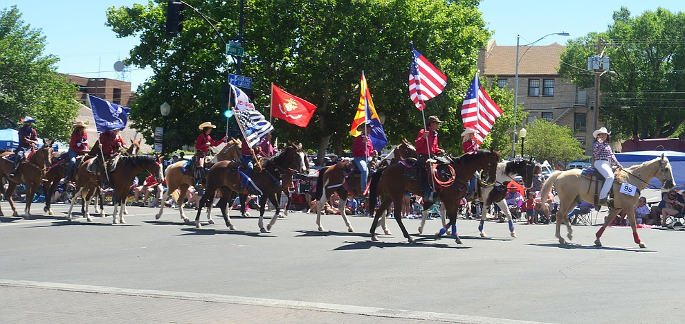 AZTrailriding.com's equestrian group during the Prescott Frontier Days Rodeo Parade through the streets of downtown Prescott Saturday July 6, 2019.  (Les Stukenberg/Courier)