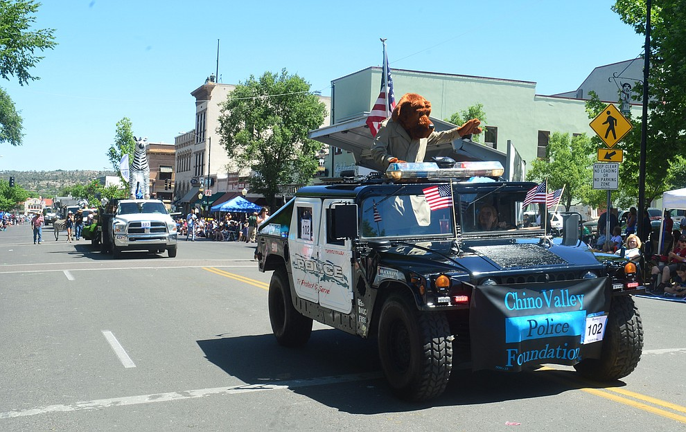 Chino ValleyPolice Foundation during the Prescott Frontier Days Rodeo Parade through the streets of downtown Prescott Saturday July 6, 2019.  (Les Stukenberg/Courier)