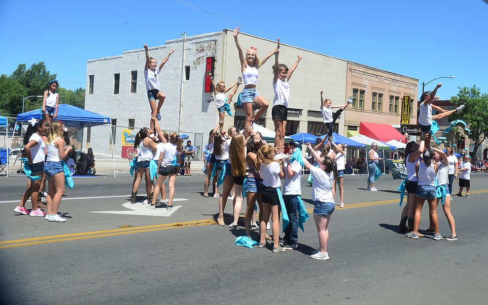 Quad-City Storm Cheer during the Prescott Frontier Days Rodeo Parade through the streets of downtown Prescott Saturday July 6, 2019.  (Les Stukenberg/Courier)