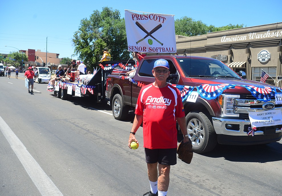 Prescott Senior Softball during the Prescott Frontier Days Rodeo Parade through the streets of downtown Prescott Saturday July 6, 2019.  (Les Stukenberg/Courier)