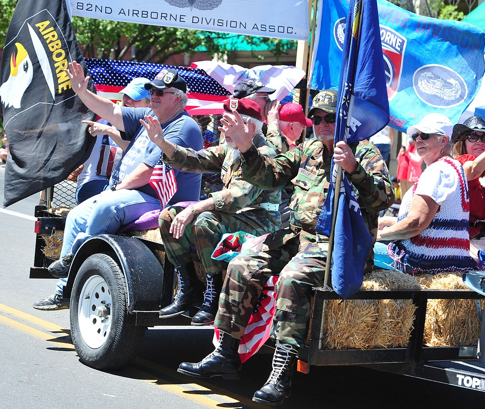 Northern Arizona All Airborne Chapter during the Prescott Frontier Days Rodeo Parade through the streets of downtown Prescott Saturday July 6, 2019.  (Les Stukenberg/Courier)