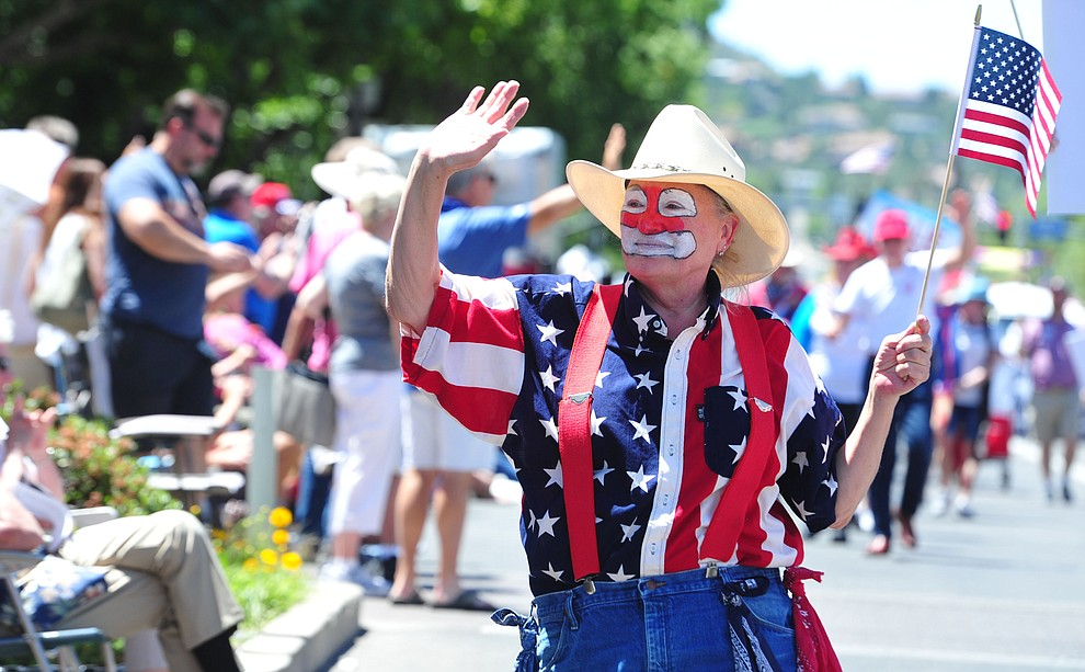 A clown during the Prescott Frontier Days Rodeo Parade through the streets of downtown Prescott Saturday July 6, 2019.  (Les Stukenberg/Courier)