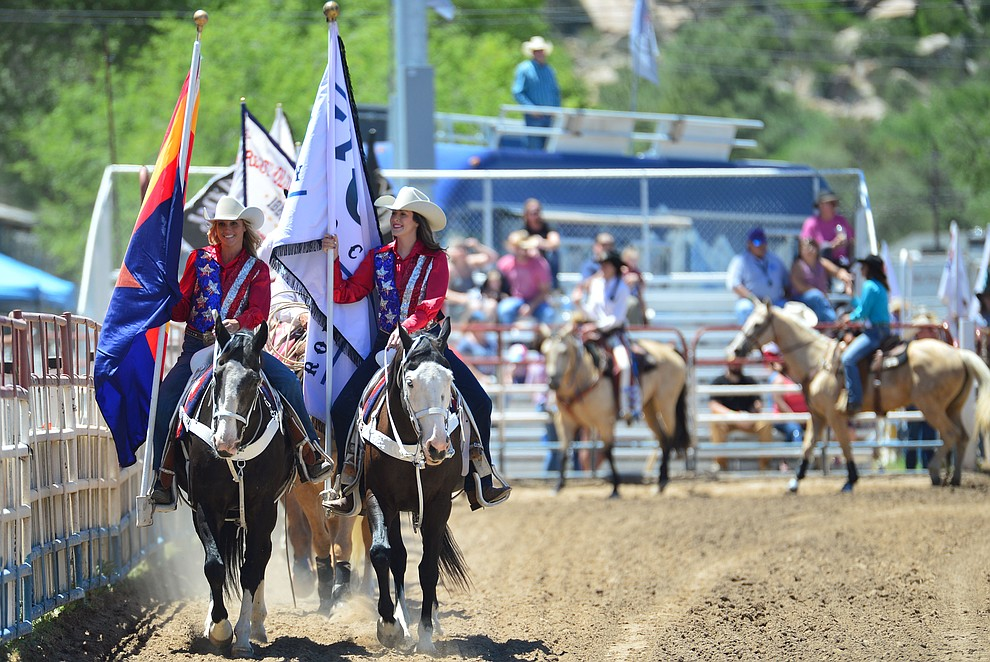 The Grand Entry begins during the 6th performance of the Prescott Frontier Days Rodeo Saturday afternoon July 6, 2019.  (Les Stukenberg/Courier)