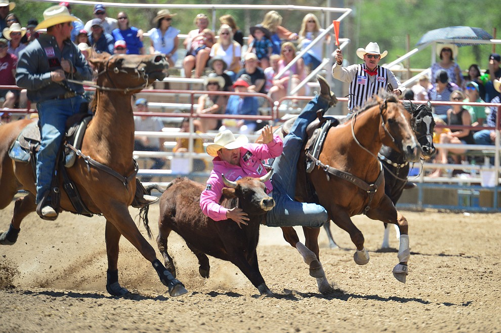 Tanner Brunner in the steer wrestling during the 6th performance of the Prescott Frontier Days Rodeo Saturday afternoon July 6, 2019.  (Les Stukenberg/Courier)