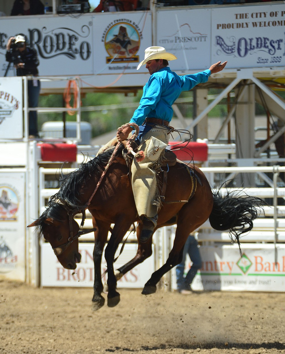 Brett Behrends scores 74 on Kevin's Pride in the Cowpunchers Bronc Riding during the 6th performance of the Prescott Frontier Days Rodeo Saturday afternoon July 6, 2019.  (Les Stukenberg/Courier)