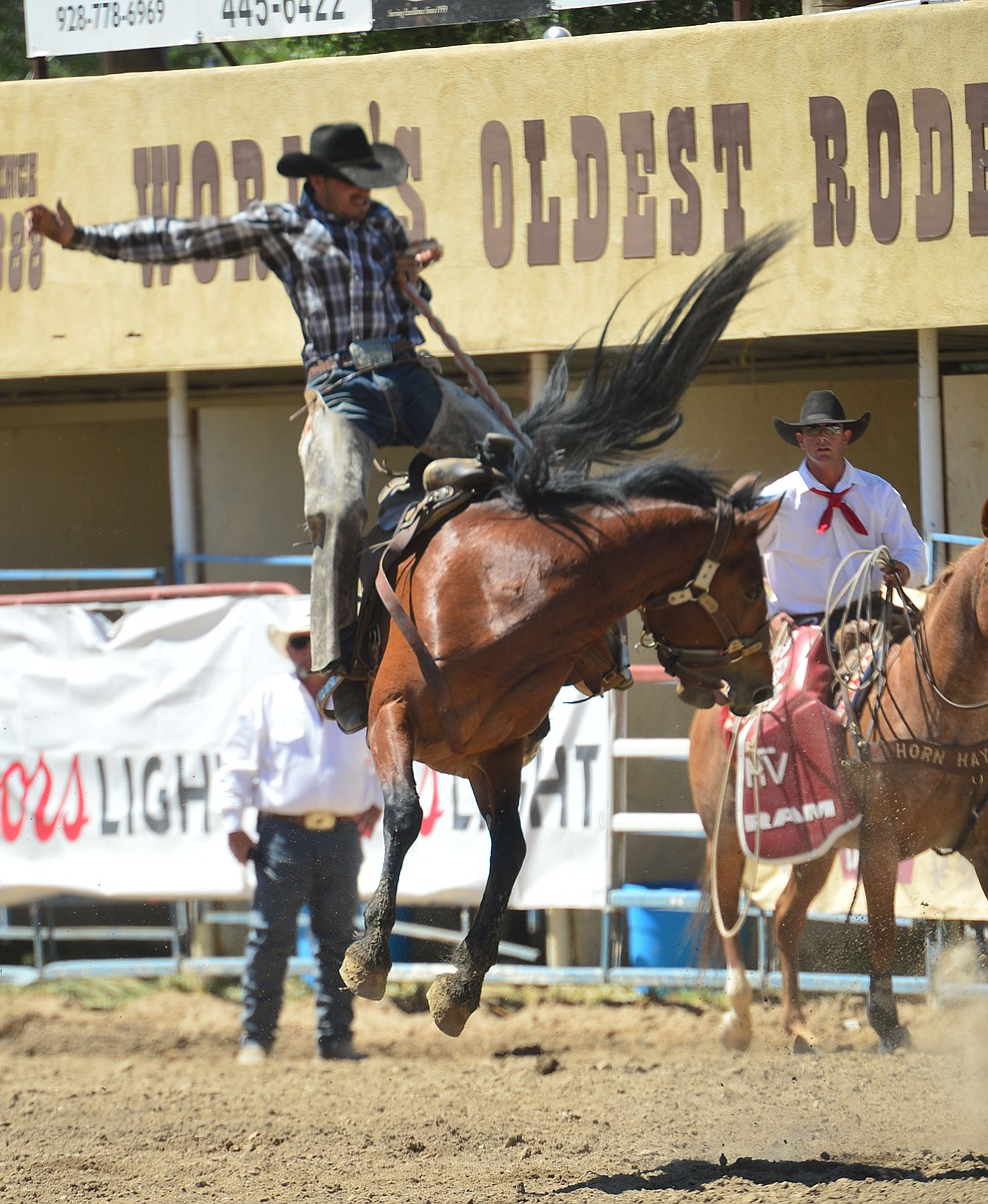 Cody Tillery on Juniper in the Cowpunchers Bronc Riding during the 6th performance of the Prescott Frontier Days Rodeo Saturday afternoon July 6, 2019.  (Les Stukenberg/Courier)