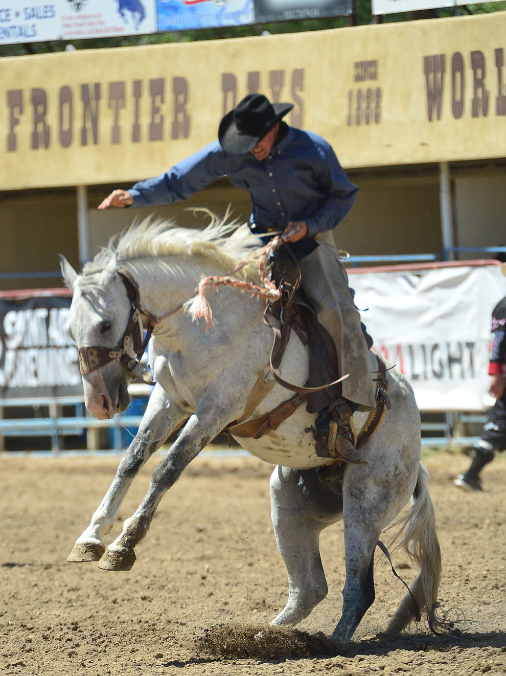 Alex Behrends on Pittsburgh in the Cowpunchers Bronc Riding during the 6th performance of the Prescott Frontier Days Rodeo Saturday afternoon July 6, 2019.  (Les Stukenberg/Courier)