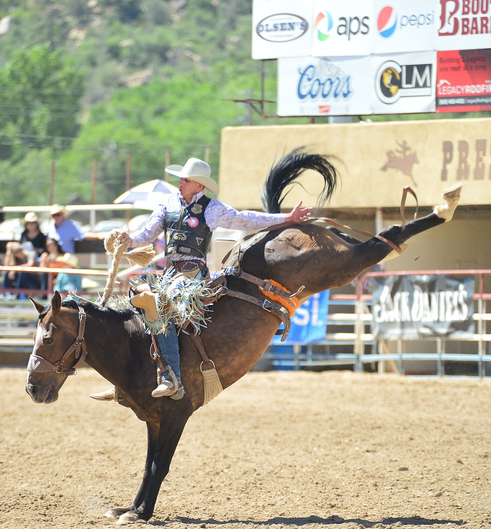 Reed Neely scores 66 on Joker in the saddle bronc riding during the 6th performance of the Prescott Frontier Days Rodeo Saturday afternoon July 6, 2019.  (Les Stukenberg/Courier)