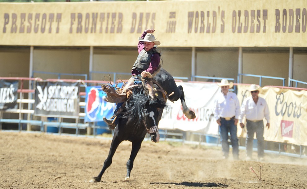 Trent Burd scores 78.5 on Mountain Climber in the saddle bronc riding during the 6th performance of the Prescott Frontier Days Rodeo Saturday afternoon July 6, 2019.  (Les Stukenberg/Courier)