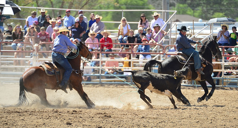 Travis Whitlow and Tanner Luttrell in the team roping during the 6th performance of the Prescott Frontier Days Rodeo Saturday afternoon July 6, 2019.  (Les Stukenberg/Courier)