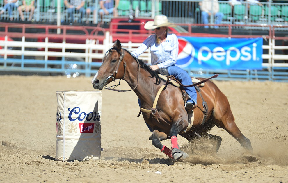 Nicole DeMers runs 17.89 seconds in the barrel race during the 6th performance of the Prescott Frontier Days Rodeo Saturday afternoon July 6, 2019.  (Les Stukenberg/Courier)