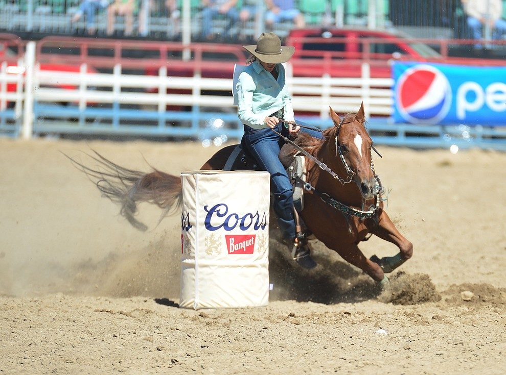 Megan Champion runs 17.82 in the barrel race during the 6th performance of the Prescott Frontier Days Rodeo Saturday afternoon July 6, 2019.  (Les Stukenberg/Courier)