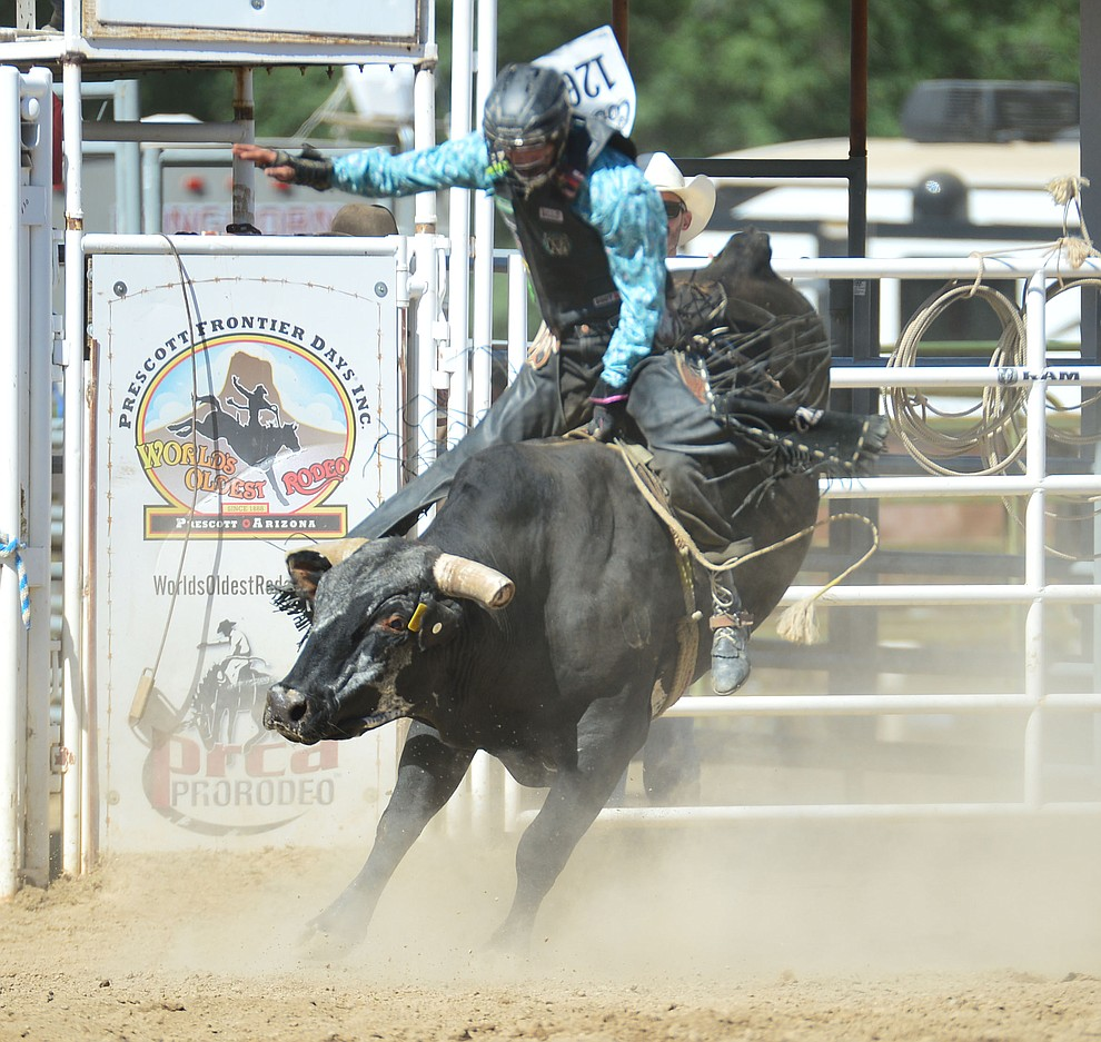 Colby Delmo on Rustler's Roost in the bull riding during the 6th performance of the Prescott Frontier Days Rodeo Saturday afternoon July 6, 2019.  (Les Stukenberg/Courier)