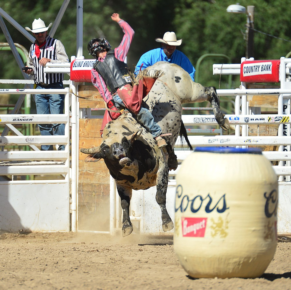 Justin Rickard on Wasted Days in the bull riding during the 6th performance of the Prescott Frontier Days Rodeo Saturday afternoon July 6, 2019.  (Les Stukenberg/Courier)