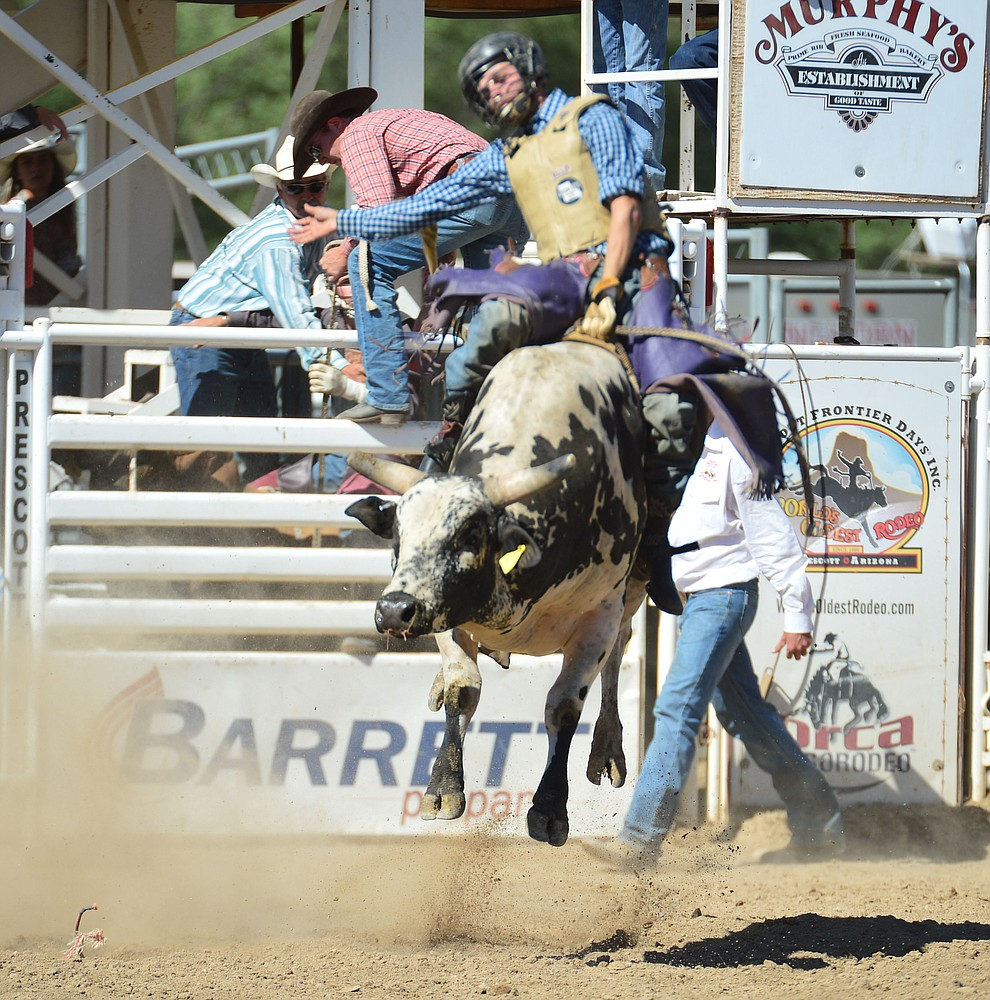 Denton Fugate on Nitro Fusion in the bull riding during the 6th performance of the Prescott Frontier Days Rodeo Saturday afternoon July 6, 2019.  (Les Stukenberg/Courier)