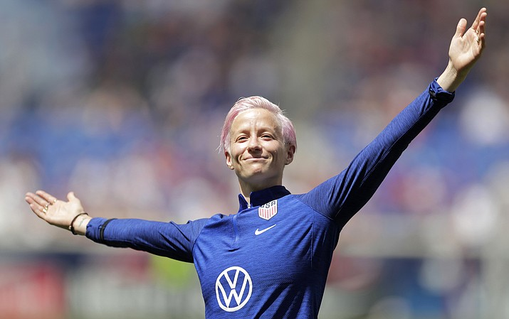 Megan Rapinoe, a forward for the United States women's national team is introduced for fans during a send-off ceremony following an international friendly soccer match against Mexico, Sunday, May 26, 2019, in Harrison, N.J. The U.S. won 3-0. (AP Photo/Julio Cortez)
