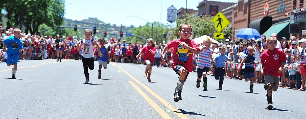 Four to five year olds race during the 37th annual Whiskey Row Boot Race on Montezuma Street in Prescott Saturday July 6, 2019.  (Les Stukenberg/Courier)