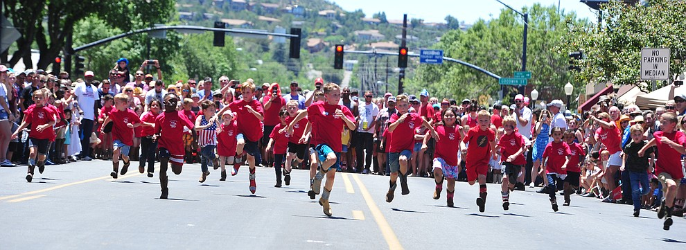 Six to eight year olds race during the 37th annual Whiskey Row Boot Race on Montezuma Street in Prescott Saturday July 6, 2019.  (Les Stukenberg/Courier)