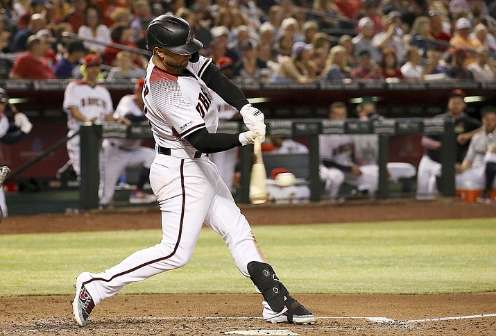 Arizona Diamondbacks' Christian Walker connects for a two-run home run against the Colorado Rockies during the fourth inning Friday, July 5, 2019, in Phoenix. (Ross D. Franklin/AP)