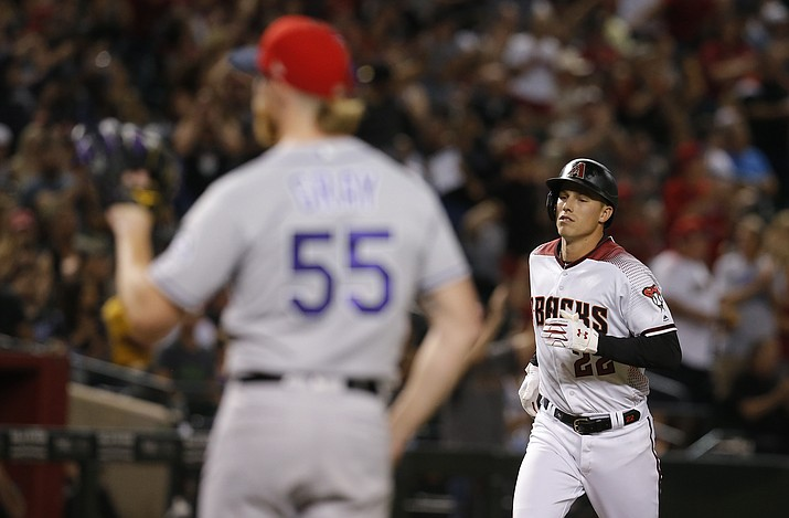 Arizona Diamondbacks' Jake Lamb (22) runs the bases after hitting a two-run home run against the Colorado Rockies during the sixth inning of a game Saturday, July 6, 2019, in Phoenix. (Rick Scuteri/AP)