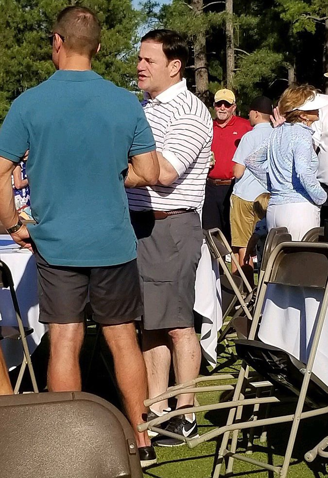 Gov. Doug Ducey attended an Independence Day celebration in Coconino County wearing Nike shoes. (Coconino County Democratic Party/Courtesy)