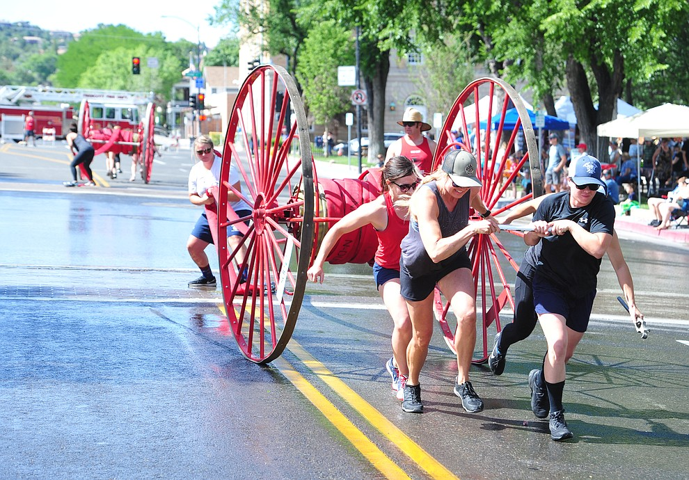 A team of all female firefighters, the first time ever, competes during the annual Hose Cart Races Sunday July 7, 2019 on Cortez Street in Prescott. The event has a history from the earliest days of the Prescott Fire Department when it was manned by volunteers. In the current version the competition has been going on for at least 70 years. (Les Stukenberg/Courier)