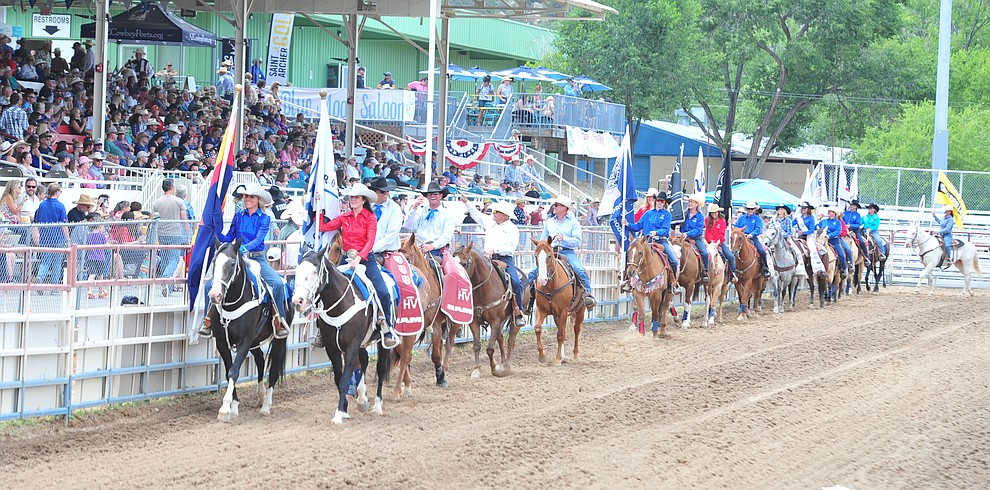The Grand Entry opens the final performance of the Prescott Frontier Days Rodeo Sunday July 7, 2019.  (Les Stukenberg/Courier)