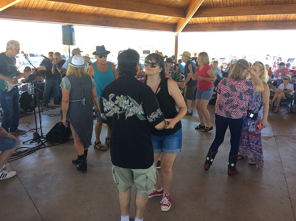 Music lovers dance to Road One South during the second annual Watson Lake Blues Festival Saturday, July 6. (Jason Wheeler/Courier)