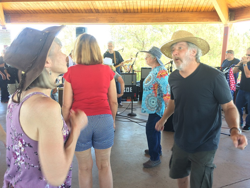 Lucy and Rich Maiorano dance to Road One South with many others during the second annual Watson Lake Blues Festival Saturday, July 6. (Jason Wheeler/Courier)