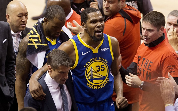 In this June 10, 2019, file photo, Golden State Warriors forward Kevin Durant (35) reacts as he leaves the court after sustaining an injury during first-half basketball action against the Toronto Raptors in Game 5 of the NBA Finals in Toronto. Durant is headed to the Brooklyn Nets, leaving the Warriors after three seasons. His decision was announced Sunday, June 30, 2019, at the start of the NBA free agency period on the Instagram page for The Boardroom, an online series looking at sports business produced by Durant and business partner Rich Kleiman. (Chris Young/The Canadian Press via AP, File)