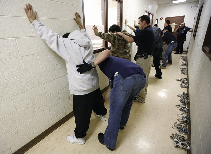 Immigrant detainees are patted down at the Immigration and Customs Enforcement's Broadview, Ill., facility on March 14, 2008. The departure of California prison inmates from an Arizona correctional center is expected to leave more room for Immigration and Customs Enforcement detainees. Up to 2,500 beds at the La Palma Correctional Center could be available for ICE detainees after California announced plans in June remove their inmates. (Brian Kersey/AP, file)